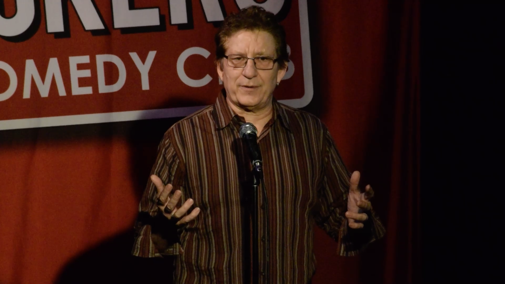 Richard Stubbs performing a stand-up comedy routine.